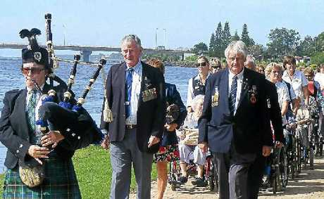 LEST WE FORGET: Piper Narelle Besseling leads the Anzac commemoration march at the Ballina Ex-Services Home on Monday, followed by Ballina RSL Sub-Branch president Bill Moore and Barry Nash.