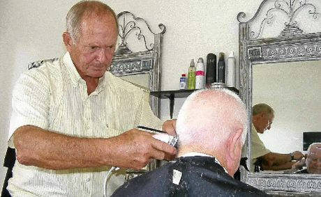 FINAL CUTS: Keith Spearing cuts long-time customer George Rumbal's hair on his final day on the job.