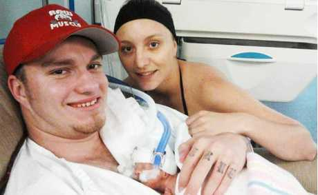 TINY BABY: Toowoomba couple Brodie Ernst and Stacey Busiko clutch their tiny daughter Mia Davis at the Mater Mothers' Hospital in Brisbane.
