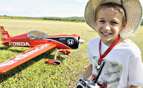 "Buderim flyer Matthew Wood, 11, with his ""Sukhoi"" model aircraft, which he flew at the Suncoast Model Flyers Air Show."