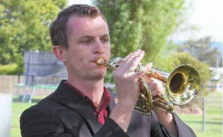 Bugler Brendan Babington played the Last Post and the Reveille at the five Warwick services.