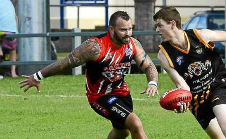 Grafton Tigers Justin Darby has the ball against Sawtell Saints at Ellem Oval on Saturday.
