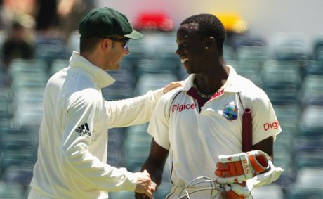 Michael Clarke of Australia shakes hands with Kemar Roach of the West Indies after Australia won the Third Test match between Australia and the West Indies at WACA
