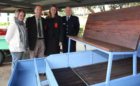 Admiring the new trailers are (from left) artist Joy Heylen, trailer project co-ordinator Simon Underwood, Toowoomba Carnival of Flowers manager Mel Kite and Darling Downs Correctional Centre general manager Peter Shaddock.