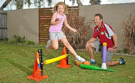 CONFIDENCE BOOST: Darryl Flashman, pictured with his daughter Rachael, 5, runs Sporty Tots, a sports program aimed at three to five-year-olds.