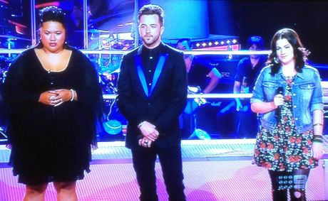 Paula Parore, left, and Karise Eden pictured with The Voice host Darren McMullen during the show's first battle round.