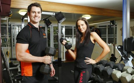 Envy this Body personal trainer Kelleigh Wallace (right) and Body of Evidence personal trainer Andrew Saunderson at their gym in Newtown.
