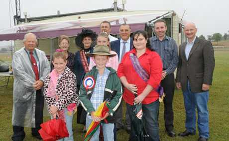 A BLESSING FOR FARMERS: Rain for the Marburg Show still brings a smile to Show Queens, politicians and Marburg Show Committee members on the weekend.