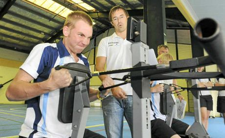 Bundaberg Sate High School's Nathan Obst determines his work rate on the rowing machine while the National Rowing Centre of Excellence's Andrew Cruickshank monitors his progress.