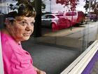 Curves manager Maria Russ looks out the window smashed on Saturday.