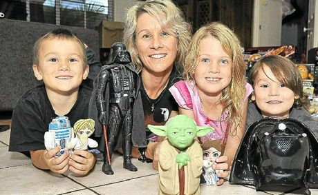Star Wars fan Michelle Podsiadly of Mountain Creek with her sons (from left) Indiana, 6, and Phoenix, 4, with her nephew Gypsy McCormack, 6.