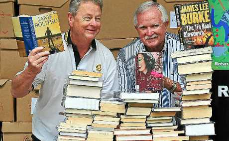 Rotary Club of Noosa Heads Daybreak Members John McAlpin (left) and Ian McDonald prepare for the bookfest at the Bicentennial Centre.