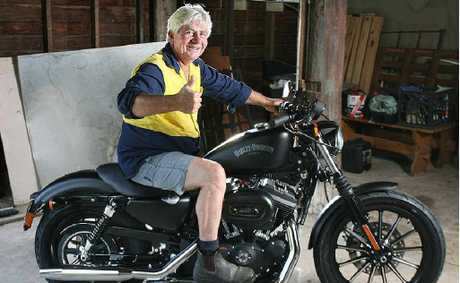 Ipswich resident Wayne Kelly is the proud owner of a Harley-Davidson motorcycle he won playing Keno.