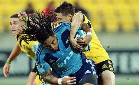 Ma'a Nonu of the Blues is tackled during the round 11 Super Rugby match between the Hurricanes and the Blues at Westpac Stadium