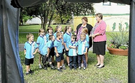Students talk with Qld School for Travelling Show Children Judy Walker and Westlawn Public School principal Narelle Twigg as the travelling school stops in at Westlawn.  