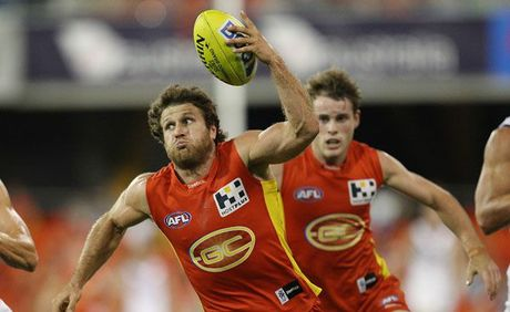 Campbell Brown of the Suns controls the ball during the round six AFL match between the Gold Coast Suns and the Fremantle Dockers at Metricon Stadium