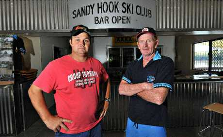 Sandy Hook Ski Club committee member Cameron McCracken and club president Col Patterson are outraged after the club was broken into by a man caught on CCTV surveillance.