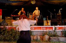 Munga Sherriff gets into the swing of Mick Thomas and the Roving Commission as they take to the stage at the Wintermoon Festival at Cameron's Pocket, north of Mackay, at the weekend.