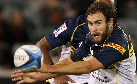 Nic White of the Brumbies kicks the ball during the round 11 Super Rugby match between the Brumbies and the Waratahs at Canberra Stadium.
