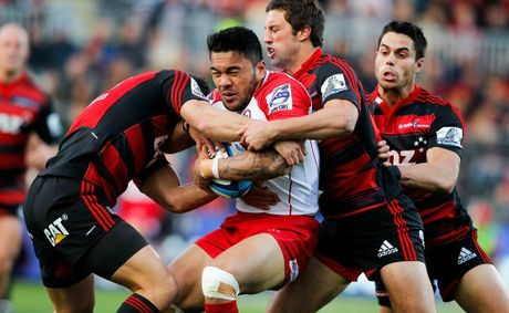 Anthony Faingaa of the Reds is tackled during the round 11 Super Rugby match between the Crusaders and the Reds at AMI Stadium