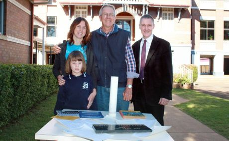 Checking out the contents of a 25-year-old time capsule buried on East State School's centenary are (from left) Taylor and Peta Chalmers with Peta's dad Stephen Byrne and principal Graeme Lacey.