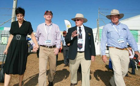 Queensland Premier Campbell Newman takes a tour of Beef Australia 2012 with his wife Lisa, Beef Australia chairman Geoff Murphy and Member for Keppel Bruce Young.