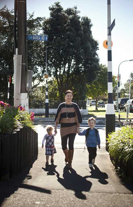Auckland Transport still haven't fixed the dangerous crossing on Marua Rd. Mum Racheal crosses with children Mia and Jack.