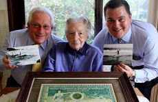 Osric Notley's relatives from the Central Coast (from left) great nephew Dennis West, niece Peggy West and great great nephew Andrew West with the original bravery award Osric Notley received for an ocean rescue on Main Beach Yamba in 1912 the family have donated to the Yamba community. PHOTO: Debrah Novak