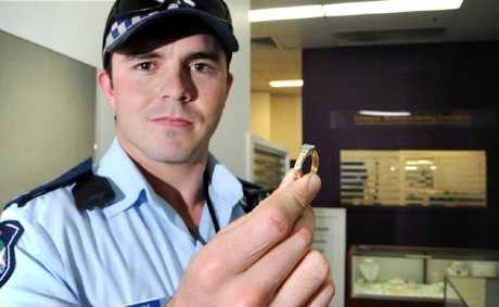Constable Clayton Sharp with the gold and diamond engagement ring.