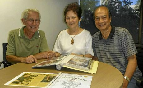 HAPPY ANNIVERSARY: Frank Heron with Therese and Rodney Madam looking over memories of the past 25 years.