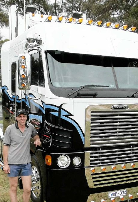 IT MUST BE LOVE: Michael Bransgrove with his souped up Freightliner Argosy.