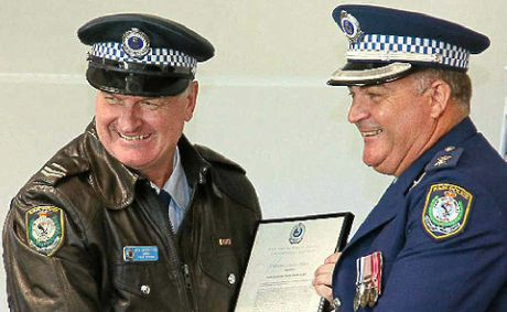 Neville Middleton presented with a 30-year clasp by Supt. Mark Holahan. Photos: FRANK REDWARD.