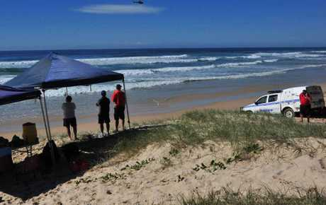 Police and surf lifesavers search for a Brisbane man on Sunday.
