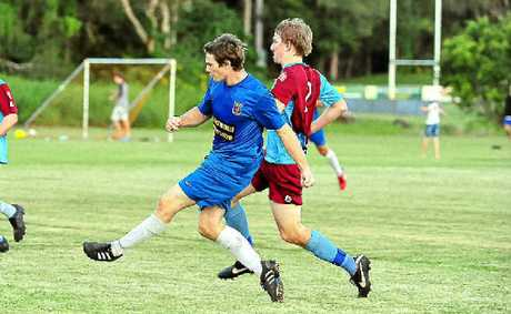Noosa Lions player Matt Thompson fires for goal.