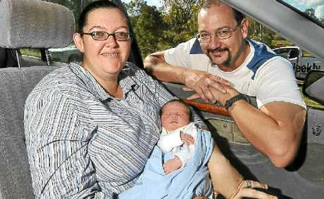 Megan and Bryant Platt with little Liam, who was born by the side of the road at Sharon, after his parents didn't make it to hospital on time.