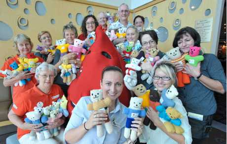 Red Cross Coffs Harbour and Woolgoolga Blood Service and C.ex Group staff proudly show off their Trauma Teddys.
