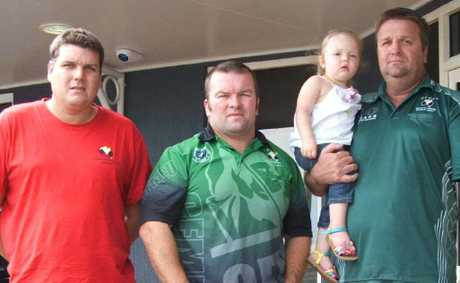 Norwich Park Mine worker Simon Potter, CFMEU district president Stephen Smyth and CFMEU Norwich Park lodge president Brad Crompton with his daughter.