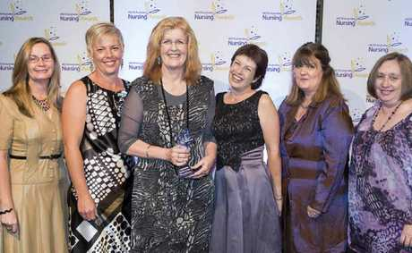 Nurse of the Year Jenny Anderson (holding award) with her support team from Rockhampton Hospital, from left, Katrina Duff, Karen Smith, Lynn Jamieson, Christine McPherson and Julie Grosse.