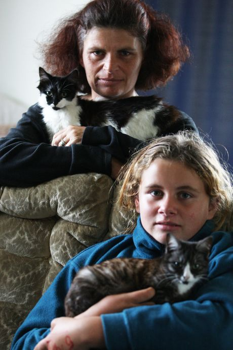 Cat owner Melissa Henderson fears someone in Papamoa is poisoning cats. Mrs Henderson is pictured with her daughter Maggie, 12.