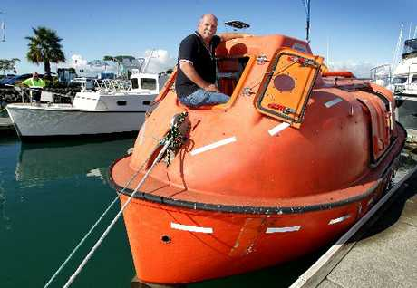 MAKING A SPLASH: Port of Tauranga worker Moss Carlin pictured in one of the lifeboats from the MV Rena, the cargo ship which ran aground off the coast of Tauranga late last year. The lifeboat will be put up for auction on Trade Me to raise funds for the Child Cancer Foundation.