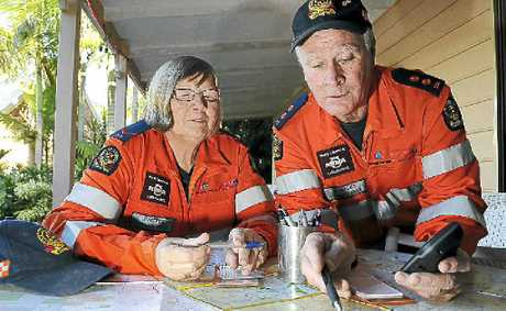 SES volunteers Jannette and Charles Elson prepare for a missing persons search exercise using maps and GPS technology.