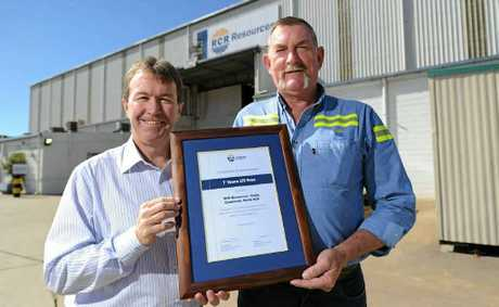RCR Resources finance manager Russell Brooke (left) congratulates Graeme McCabe, workshop operations manager.