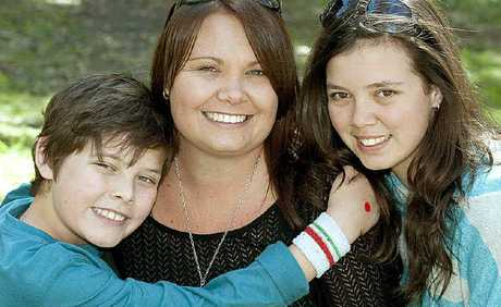 Tracy Vayro gets a Mother's Day hug from son Connor and daughter Kristy during yesterday's family fun day at Kearneys Spring Park.