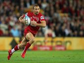 Quade Cooper of the Reds runs the ball during the 2011 Super Rugby Grand Final match between the Reds and the Crusaders at Suncorp Stadium on July 9, 2011 in Brisbane, Australia.