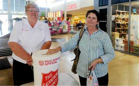 Salvation Army Sergeant Major Ruth Saroglia accepts a donation from Anne Lutz at Sydney Street Markets.