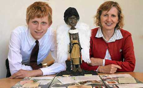 Acting principal Janelle Robb is proud of Year 9 student Dylan Treasure's entry in the National History Challenge.