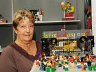 Lego steward Cheryl Patterson holds Jeremy Wilsons Brick Day Out which won first place in the age 7-9 original design category.