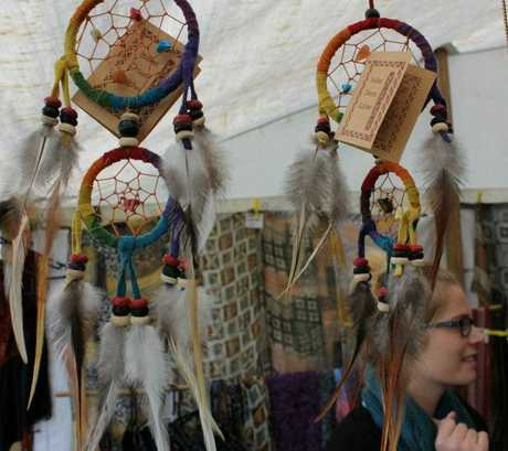 Shoppers browse the goods on sale at the Gypsy Fair.