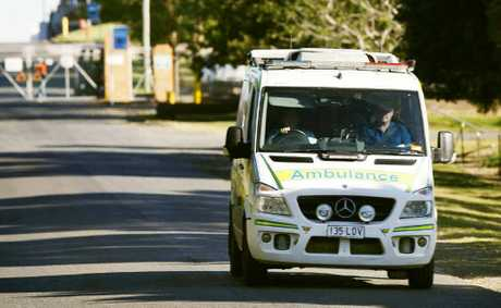 An ambulance leaves the Bundamba factory after the man's death.