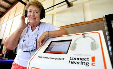 Rita Fortune tests her hearing at the Seniors Expo.